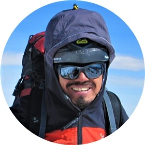Jaime Vargas with black sunglasses and mountaineer equipment