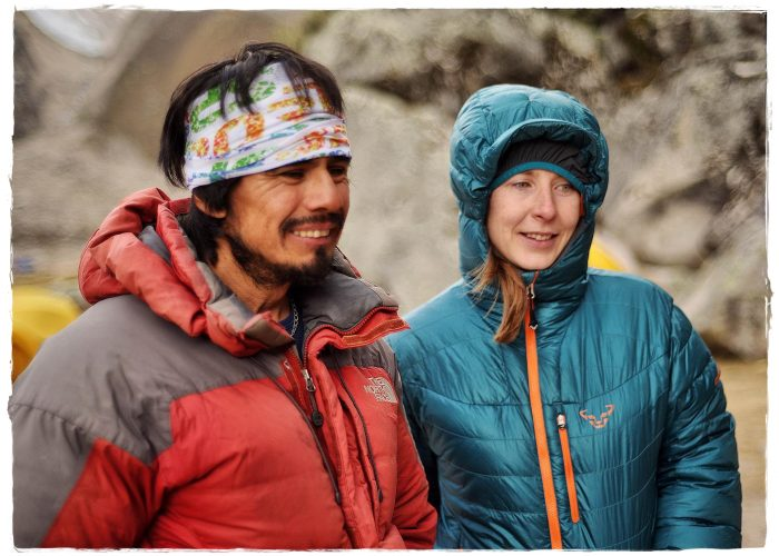 Elisabeth Gschösser and Jaime Vargas are smiling in red and blue jackets